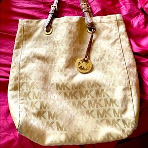 Original Micheal kors hand bag in canvas with leather straps. Gently used.
